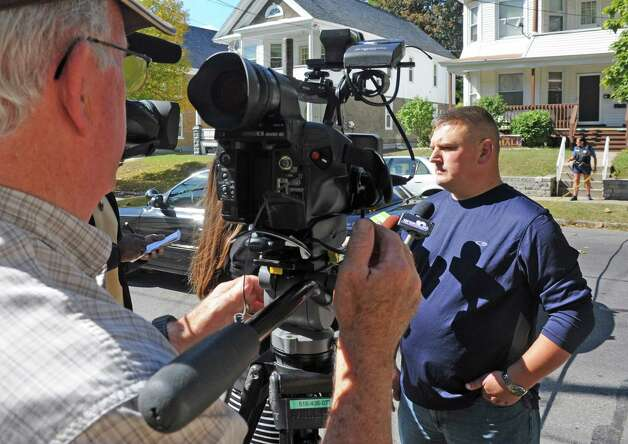 Schenectady Police Lieutenant Mark McCraken speaks with the media following a standoff at 315-317 McClellan Street on Friday, Sept. 26, 2014, in Schenectady, N.Y.  (Michael P. Farrell/Times Union) Photo: Michael P. Farrell