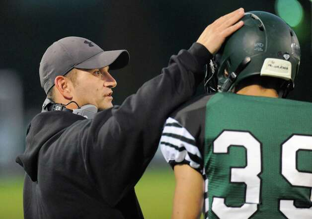 Schalmont head coach Joe Whipple instructs his players against Burnt Hills-Ballston Lake during the first half of their Section II football game on Friday, Sept. 26, 2014, in Rotterdam, N.Y., (Hans Pennink / Special to the Times Union) ORG XMIT: HP101 Photo: Hans Pennink / Hans Pennink