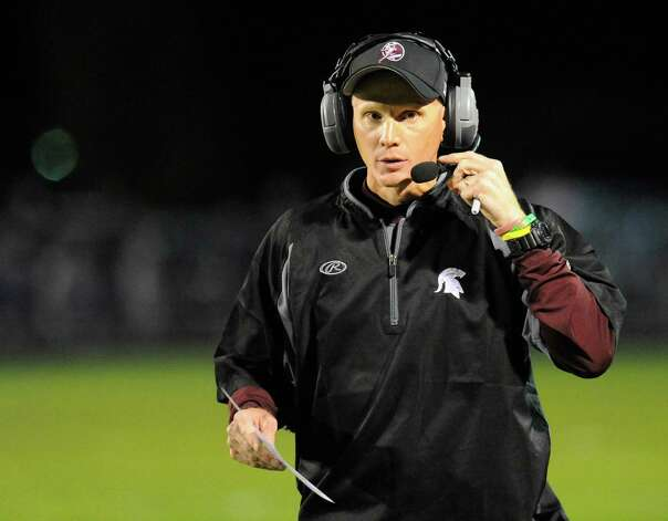 Burnt Hills-Ballston Lake head coach Matt Shell instructs his players against Schalmont during the first half of their Section II football game on Friday, Sept. 26, 2014, in Rotterdam, N.Y., (Hans Pennink / Special to the Times Union) ORG XMIT: HP103 Photo: Hans Pennink / Hans Pennink