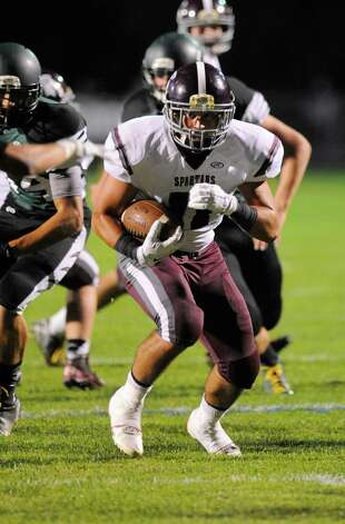 Burnt Hills-Ballston Lake's James Prezioso (11) runs for a touchdown against Schalmont during the first half of their Section II football game on Friday, Sept. 26, 2014, in Rotterdam, N.Y., (Hans Pennink / Special to the Times Union) ORG XMIT: HP106 Photo: Hans Pennink / Hans Pennink