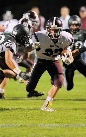 Burnt Hills-Ballston Lake's Michael Leveroni (22) runs the ball against Schalmont during the first half of their Section II football game on Friday, Sept. 26, 2014, in Rotterdam, N.Y., (Hans Pennink / Special to the Times Union) ORG XMIT: HP107 Photo: Hans Pennink / Hans Pennink