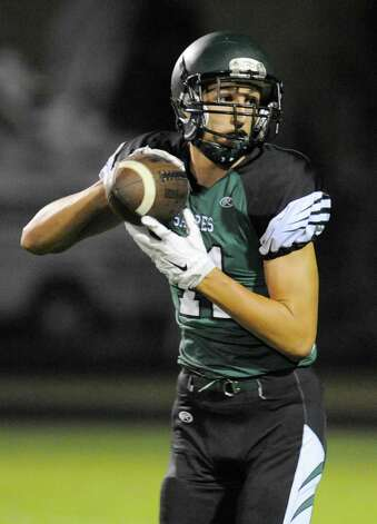 Schalmont's Zac O' Dell (11) catches a pass and runs for a touchdown  against Burnt Hills-Ballston Lake during the first half of their Section II  football game on Friday, Sept. 26, 2014, in Rotterdam, N.Y., (Hans Pennink / Special to the Times Union) ORG XMIT: HP109 Photo: Hans Pennink / Hans Pennink
