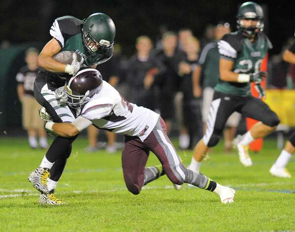 Schalmont running back Hunter Gac ,left, is stoped by Burnt Hills-Ballston Lake defensive back Maxwell Charlton during the first half of their Section II football game on Friday, Sept. 26, 2014, in Rotterdam, N.Y., (Hans Pennink / Special to the Times Union) ORG XMIT: HP113 Photo: Hans Pennink / Hans Pennink