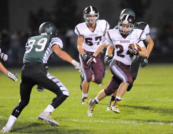 Burnt Hills-Ballston Lake's Johnny O'Donnell (24) runs the ball against Schalmont during the first half of their Section II  football game on Friday, Sept. 26, 2014, in Rotterdam, N.Y., (Hans Pennink / Special to the Times Union) ORG XMIT: HP114 Photo: Hans Pennink / Hans Pennink