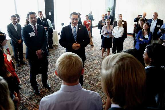 Romanian Prime Minister Victor Ponta meets with area high school students prior to speaking at the Petroleum Club Friday.