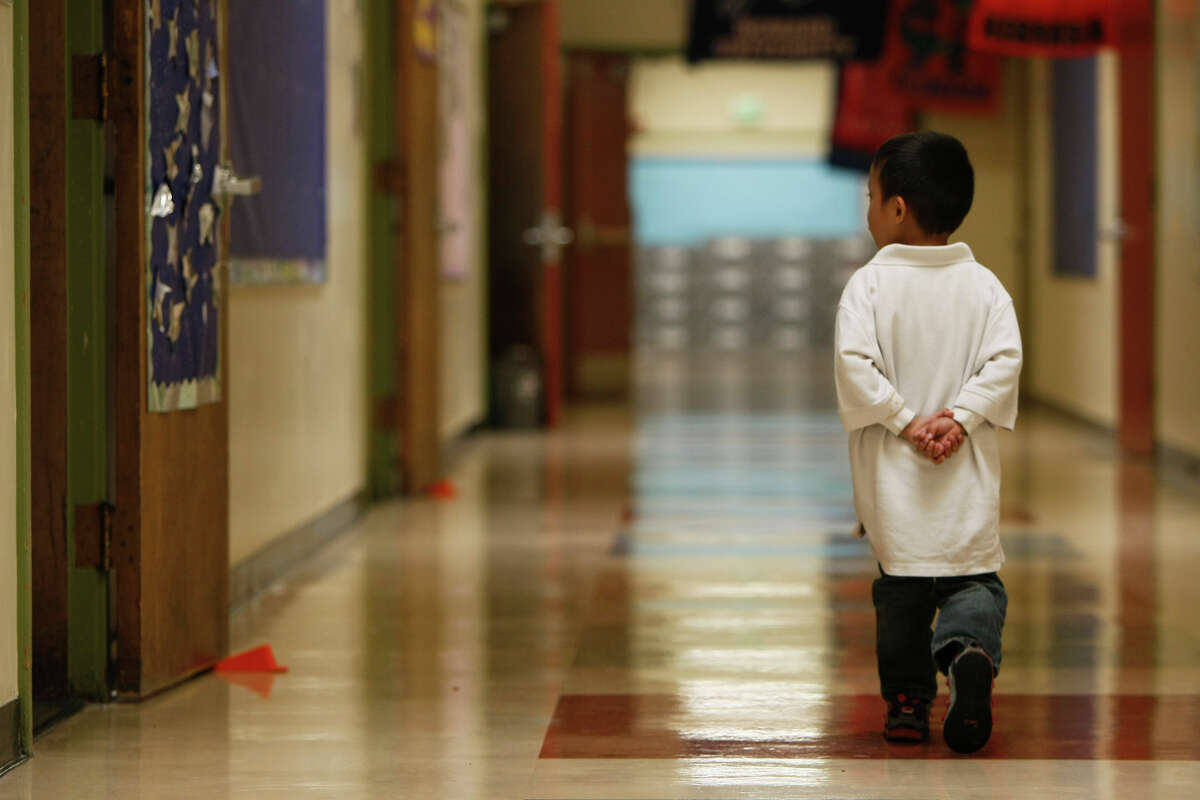 A student walks down a hall at Garfield Elementary School in Oakland.