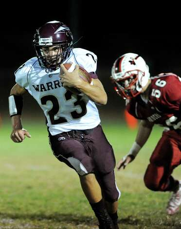 Stillwater's Ezra Echeandia, left, carries the ball as Mechanicville's Alexander Bechand defends during their football game on Friday, Sept. 26, 2014, at Mechanicville High in Mechanicville, N.Y. (Cindy Schultz / Times Union) Photo: Cindy Schultz / 00028775A