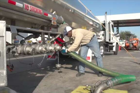 Isaac Woodard of Susser Petroleum offloads fuel at a Stripes convenience store in Houston. The wholesale fuel distributor - one of the largest non-refiner distributors in Texas - was spun off by Stripes owner Susser Holdings Corp. as Susser Petroleum Partners in a September 2012 IPO.