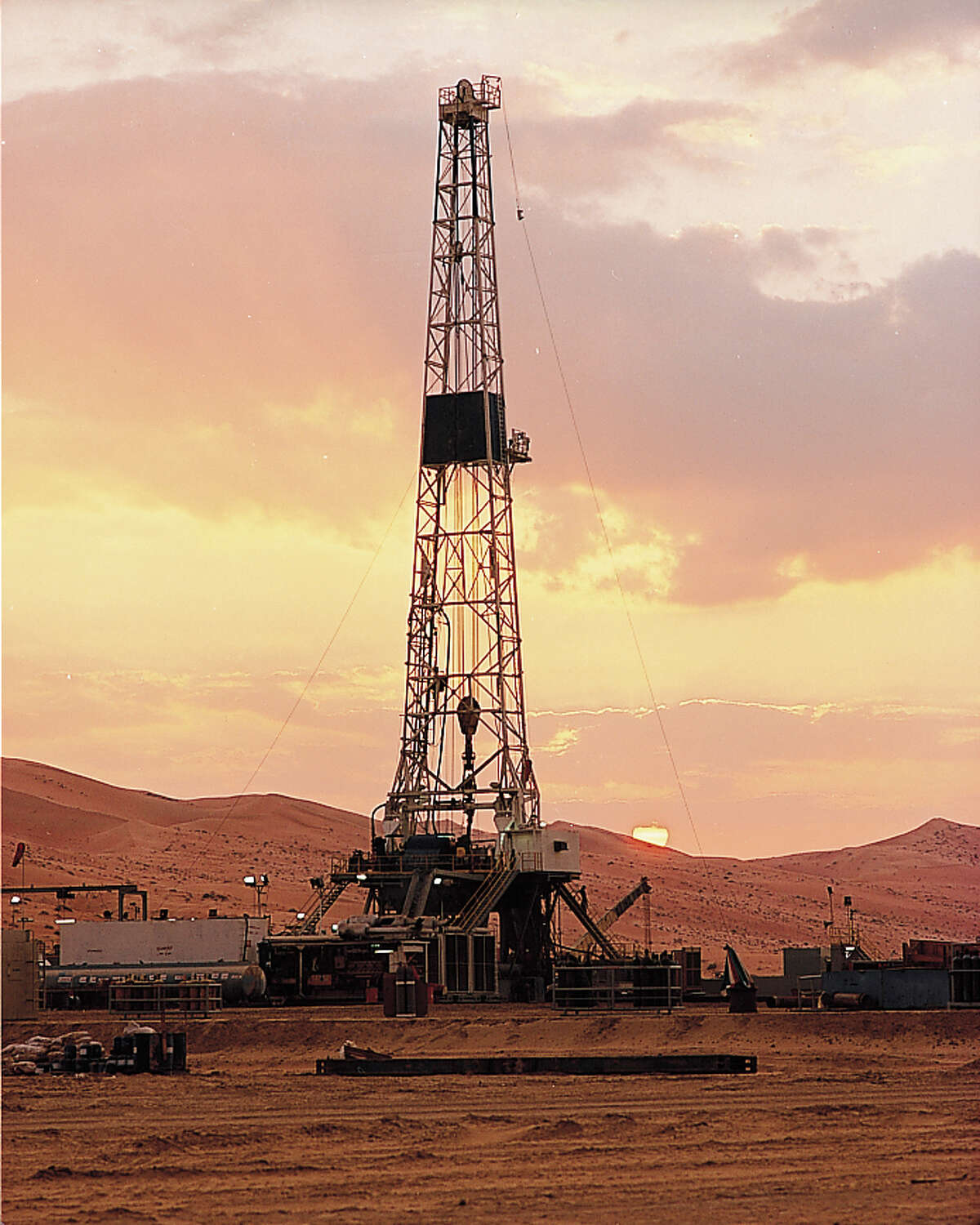 An oil rig works in Saudi Arabia, which has lowered its oil prices to compete with U.S. production, rather than employing its historical tactic of cutting output to force up prices. (Saudi Aramco photo)