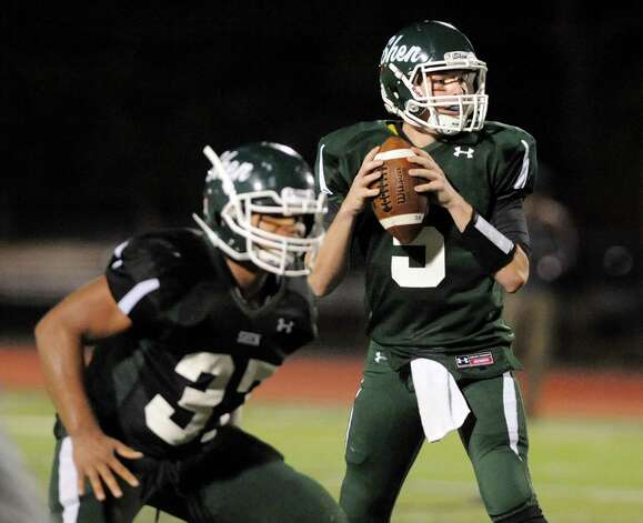 Shen's quarterback Ryan Van Galen, right, looks to pass during their football game against Saratoga on Friday, Sept. 26, 2014, at Shenendehowa High in Clifton Park, N.Y. (Cindy Schultz / Times Union) Photo: Cindy Schultz / 00028776A