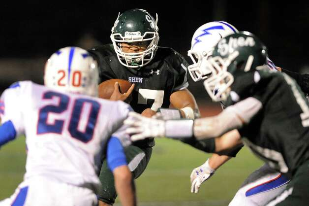 Shen's Oliver Robinson, center, carries the ball during their football game against Saratoga on Friday, Sept. 26, 2014, at Shenendehowa in Clifton Park, N.Y. (Cindy Schultz / Times Union) Photo: Cindy Schultz / 00028776A