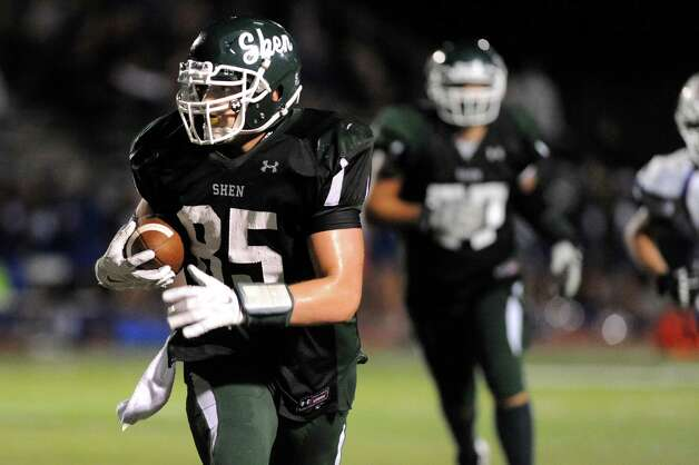 Shen's Erik Kromer, left, carries the ball during their football game against Saratoga on Friday, Sept. 26, 2014, at Shenendehowa in Clifton Park, N.Y. (Cindy Schultz / Times Union) Photo: Cindy Schultz / 00028776A