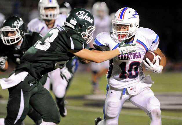 Saratoga's Nick Anderson, right, fights off Shen's Jordan Zlogar during their football game on Friday, Sept. 26, 2014, at Shenendehowa High in Clifton Park, N.Y. (Cindy Schultz / Times Union) Photo: Cindy Schultz / 00028776A