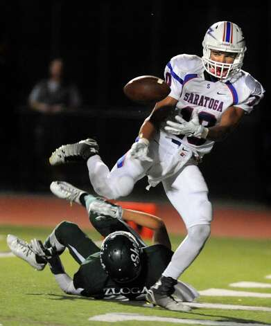 Saratoga's Nick Anderson, right, breaks up a pass intended for Shen's Jordan Zlogar during their football game on Friday, Sept. 26, 2014, at Shenendehowa High in Clifton Park, N.Y. (Cindy Schultz / Times Union) Photo: Cindy Schultz / 00028776A