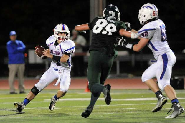 Saratoga's quarterback Brian Williams, left, tries to get off a pass during their football game  against Shen on Friday, Sept. 26, 2014, at Shenendehowa High in Clifton Park, N.Y. (Cindy Schultz / Times Union) Photo: Cindy Schultz / 00028776A