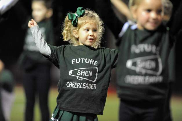 Future Shen cheerleader Cameron Calisi, 4, takes part in the halftime show during their football game against Saratoga on Friday, Sept. 26, 2014, at Shenendehowa High in Clifton Park, N.Y. (Cindy Schultz / Times Union) Photo: Cindy Schultz / 00028776A
