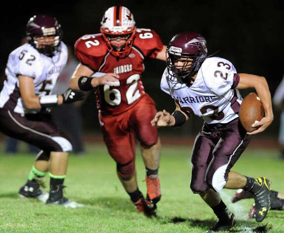 Stillwater's Ezra Echeandia, left, carries the ball as Mechanicville's Brennan Fleming defends during their football game on Friday, Sept. 26, 2014, at Mechanicville High in Mechanicville, N.Y. (Cindy Schultz / Times Union) Photo: Cindy Schultz / 00028775A