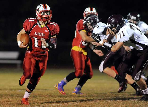 Mechanicville's quarterback Brandon Russell, left, carries the ball during their football game against Stillwater on Friday, Sept. 26, 2014, at Mechanicville High in Mechanicville, N.Y. (Cindy Schultz / Times Union) Photo: Cindy Schultz / 00028775A