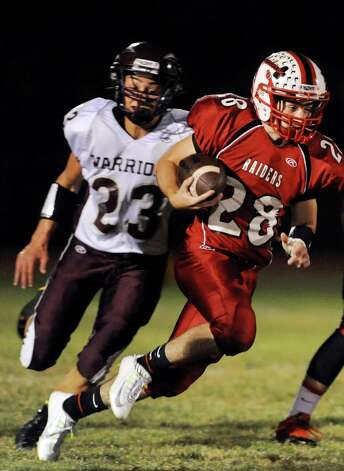 Mechanicville's Jacob Henes, right, carries the ball as Stillwater's Ezra Echeandia defends during their football game on Friday, Sept. 26, 2014, at Mechanicville High in Mechanicville, N.Y. (Cindy Schultz / Times Union) Photo: Cindy Schultz / 00028775A