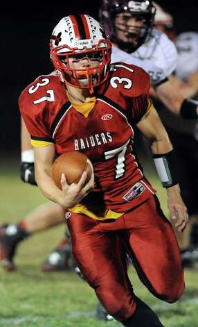 Mechanicville's Chase DeLossantos carries the ball during their football game against Stillwater on Friday, Sept. 26, 2014, at Mechanicville High in Mechanicville, N.Y. (Cindy Schultz / Times Union) Photo: Cindy Schultz / 00028775A