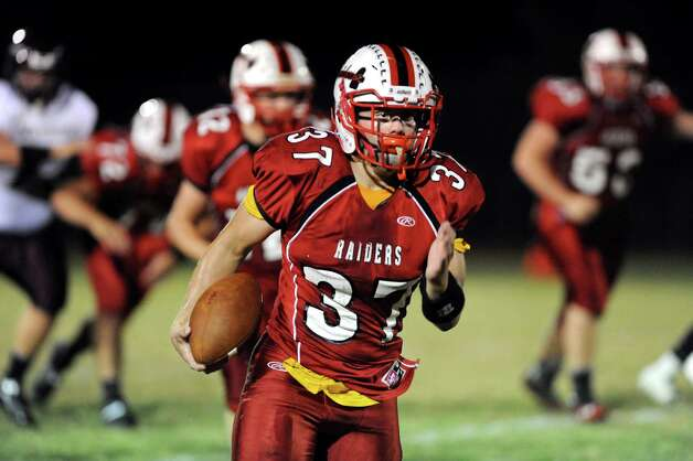 Mechanicville's Chase DeLossantos, center, carries the ball during their football game against Stillwater on Friday, Sept. 26, 2014, at Mechanicville High in Mechanicville, N.Y. (Cindy Schultz / Times Union) Photo: Cindy Schultz / 00028775A
