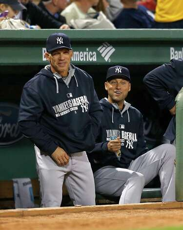 BOSTON, MA - SEPTEMBER 26:  Derek Jeter #2 of the New York Yankees laughs with Joe Girardi #28 from the dugout during a game against the Boston Red Sox at Fenway Park on September 26, 2014 in Boston, Massachusetts. (Photo by Jim Rogash/Getty Images) ORG XMIT: 477590633 Photo: Jim Rogash / 2014 Getty Images