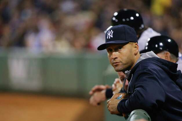 BOSTON, MA - SEPTEMBER 26:  Derek Jeter #2 of the New York Yankees looks on from the dugout during the game against the Boston Red Sox at Fenway Park on September 26, 2014 in Boston, Massachusetts.  (Photo by Al Bello/Getty Images) ORG XMIT: 477590633 Photo: Al Bello / 2014 Getty Images