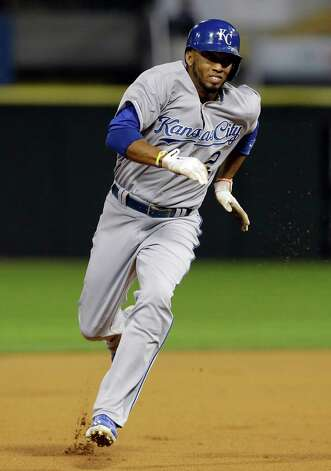 Kansas City Royals' Alcides Escobar runs to home after Nori Aoki, of Japan, hit a triple during the first inning of a baseball game against the Chicago White Sox in Chicago on Friday, Sept. 26, 2014. (AP Photo/Nam Y. Huh) ORG XMIT: CXS104 Photo: Nam Y. Huh / AP