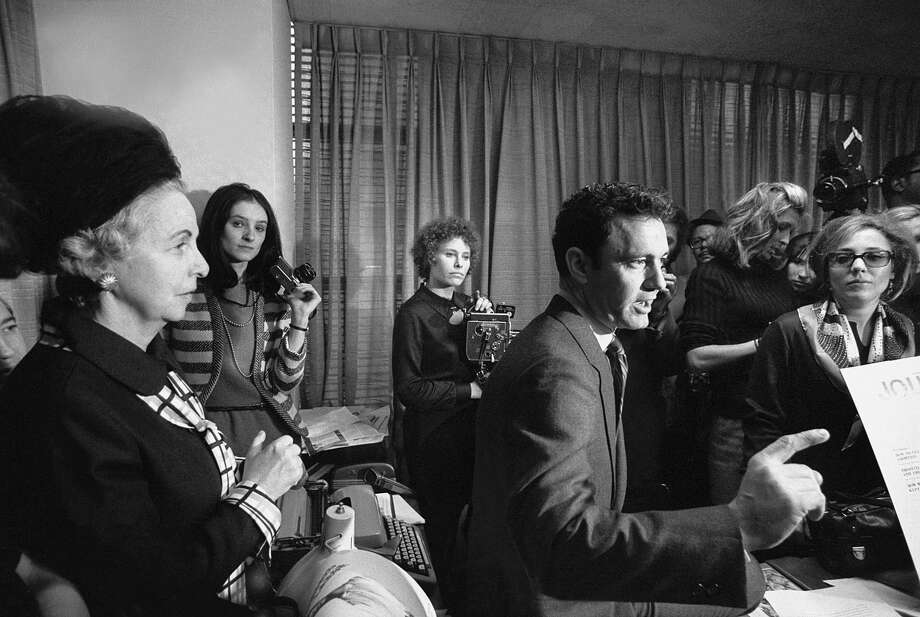 John Mack Carter, a Kentucky-born journalist, with a group of feminists who invaded his office at the Ladies' Home Journal in New York in 1970 and held him hostage, demanding changes in the magazine. Photo: JACK MANNING / New York Times / NYTNS