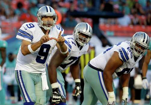 Dallas Cowboys quarterback Tony Romo (9) calls a play from the line of scrimmage during the first half of an NFL preseason football game, Saturday, Aug. 23, 2014 in Miami Gardens, Fla. (AP Photo/Lynne Sladky) Photo: Associated Press / AP