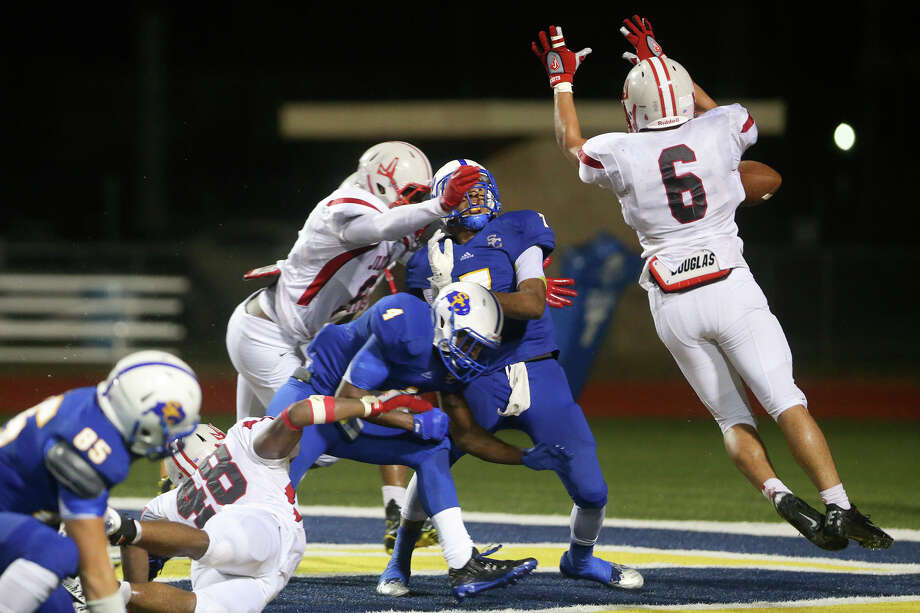 Clemens' quarterback Frank harris (center) loses the ball in the end zone resulting in a Rocket touchdown during the second half of their District 26-6A opener at Lenhoff Stadium on Friday, Sept. 26, 2014.   MARVIN PFEIFFER/ mpfeiffer@express-news.net Photo: MARVIN PFEIFFER, MARVIN PFEIFFER/ Mpfeiffer@express-news.net / Express-News 2014