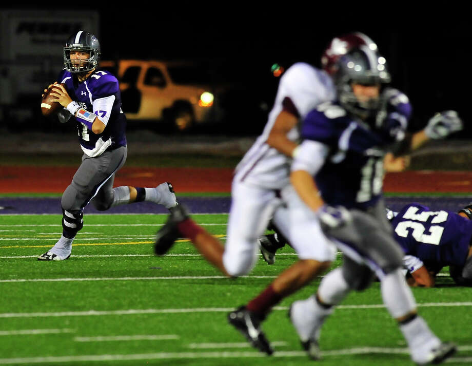 Port Neches-Groves'  Adam Morse looks for an open teammate during Friday night's home game against Baytown Lee in the District 22-5A opener. Photo taken Friday, September 26, 2014 Kim Brent/@kimbpix Photo: KIM BRENT / Beaumont Enterprise