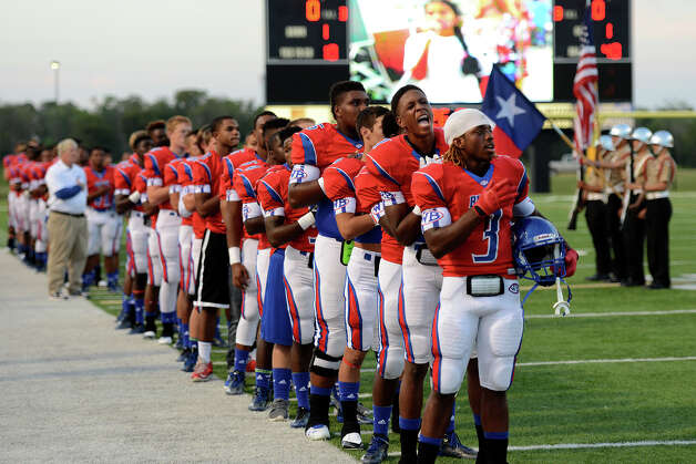 The West Brook Bruins participate in the pregame anthem before the match up against the North Shore Mustangs at the Carroll Thomas Stadium September 26, 2014. Photo by Drew Loker. Photo: Drew Loker / ©2014. www.DrewLoker.com