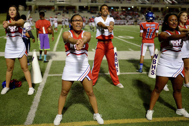 West Brook Bruins cheerleaders pep up the crowd during the match against the North Shore Mustangs at the Carroll Thomas Stadium September 26, 2014. Photo by Drew Loker. Photo: Drew Loker / ©2014. www.DrewLoker.com