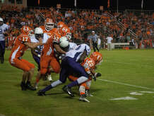 Orangefield defender tackle an Newton player during last Friday's game at F.L. McClain Stadium. The Bobcats upset the Eagles 26-20. Photo provided by Miguel Perez