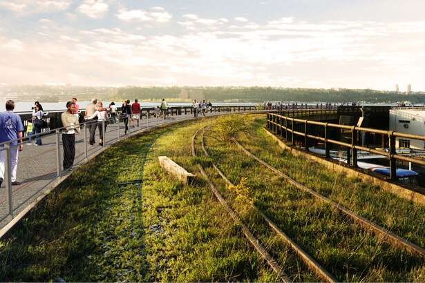 "In this artist rendering provided by the ?""Friends of the High Line,?"" the High Line?'s interim walkway, looking northwest, where the High Line curves north at the intersection of West 30th Street and 12th Avenue in New York is shown."