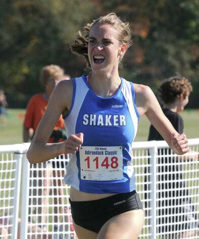 Shaker's Maryanna Lansing wins the girls's varsity division one portion of the Queensbury Invitational Cross Country meet on Saturday Sept. 27, 2014 in Queensbury, N.Y.  (Michael P. Farrell/Times Union) Photo: Michael P. Farrell / 00028749A