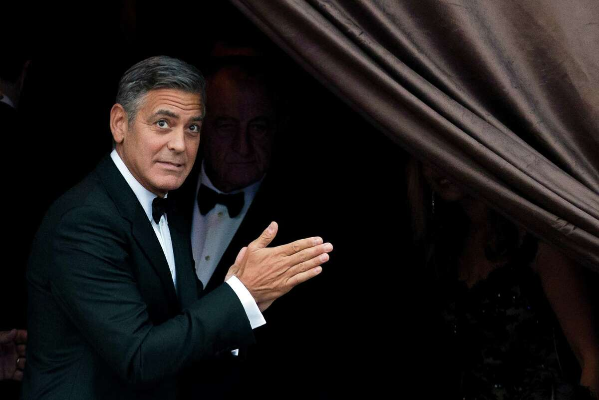 George Clooney arrives at the Aman hotel in Venice, Italy, Saturday, Sept. 27, 2014, ahead of his wedding to human rights lawyer Amal Alamuddin in the romantic lagoon city.