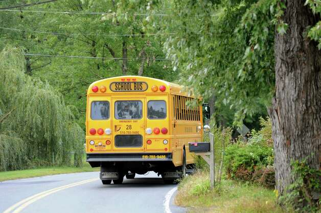 A school bus takes students home on Thursday, Sept. 18, 2014, in Latham, N.Y. (Cindy Schultz / Times Union) Photo: Cindy Schultz
