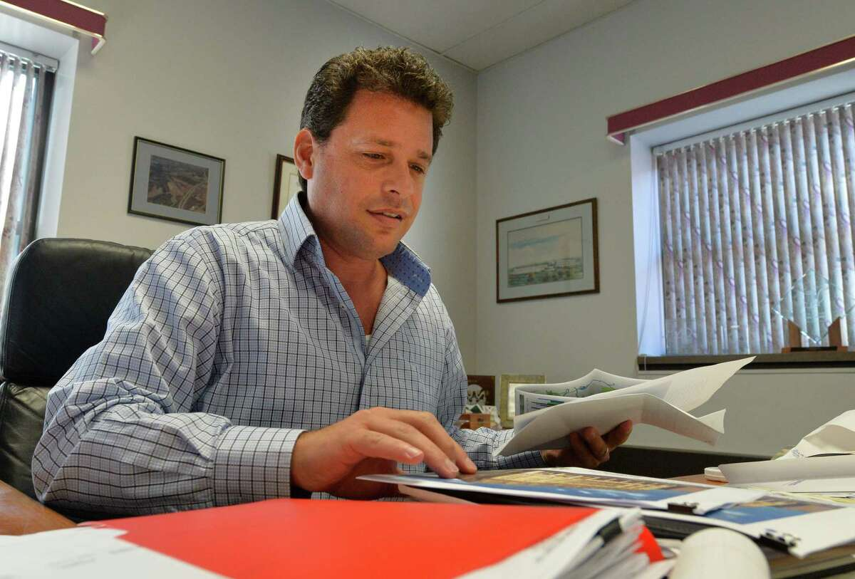 IDA executive director Robert Pasinella works in his office in the Rensselaer County Office building in Tuesday morning Sept. 9, 2014 in Troy, N.Y. The IDA recently hired Mower, the public relations agency. (Skip Dickstein/Times Union)