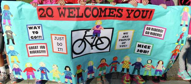 "Birchwood Elementary School (Niskayuna) students greet riders with the annual Bike Ride for Missing Children of the Greater Capital District on Saturday, with posters, high-fives and cheers of ""Go, Riders, Go!"" (Submitted photo)"