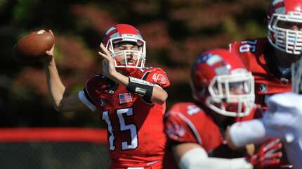 New Canaan quarterback Michael Collins (15) throws a pass in New Canaan's 35-20 win over Greenwich in the high school football game at New Canaan High School in New Canaan, Conn. Saturday, Sept. 27, 2014.