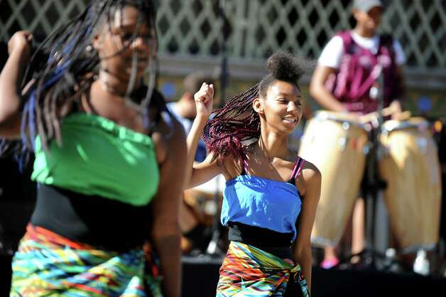 Rihnay McGriff, 18, center, and Shontia Thomas, 15, members of the Student Theater Outreach Program, perform a dance before  the start of the Capital Region AIDSWalk on Saturday, Sept. 27, 2014, at Washington Park in Albany, N.Y. The walk, sponsored by by CARES Inc. and the Community AIDS Partnership of the Capital Region, raises funds to benefit local HIV and AIDS service groups. (Cindy Schultz / Times Union) Photo: Cindy Schultz / 10028782A