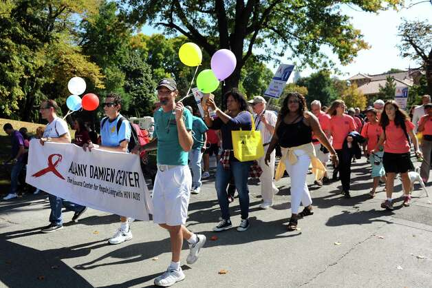 Participants begin the Capital Region AIDSWalk on Saturday, Sept. 27, 2014, at Washington Park in Albany, N.Y. The walk, sponsored by by CARES Inc. and the Community AIDS Partnership of the Capital Region, raises funds to benefit local HIV and AIDS service groups. (Cindy Schultz / Times Union) Photo: Cindy Schultz / 10028782A