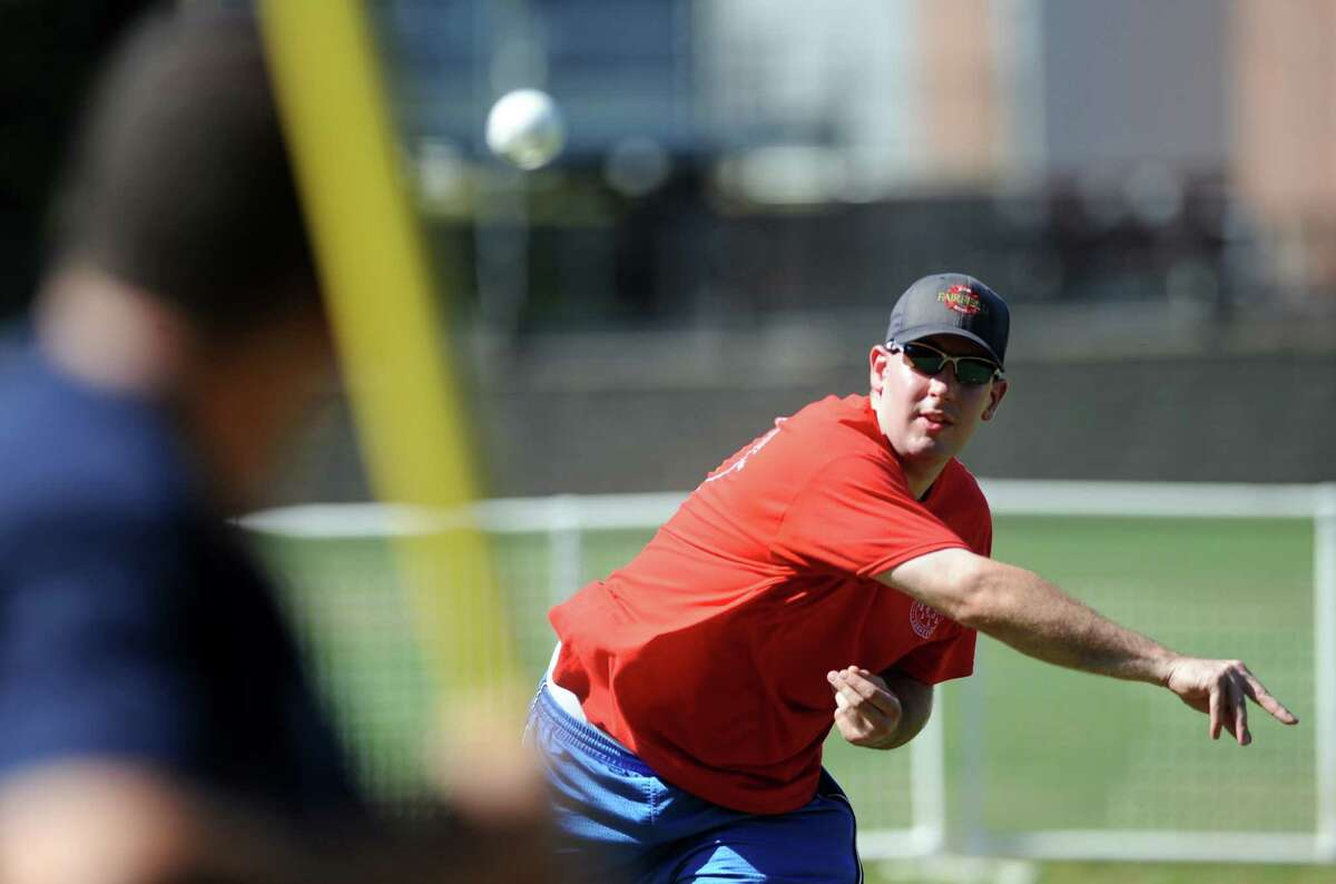 Fairfield Firefighter Mark Smuda pitches to the Police Dept. team Saturday, Sept. 27, 2014 during a Wiffle Ball tournament to celebrate Fairfield's 375th anniversary between Town Hall, Police Dept., Fire Dept., and DPW employees at Roger Ludlowe Middle School.