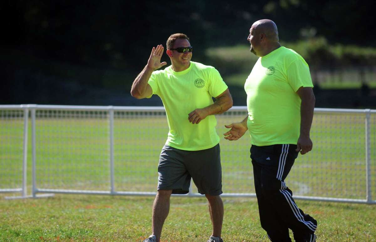 Town Hall, Police Dept., Fire Dept., and Public Works employees compete in a Wiffle Ball tournament Saturday, Sept. 27, 2014 at Roger Ludlowe Middle School to celebrate Fairfield's 375th anniversary.