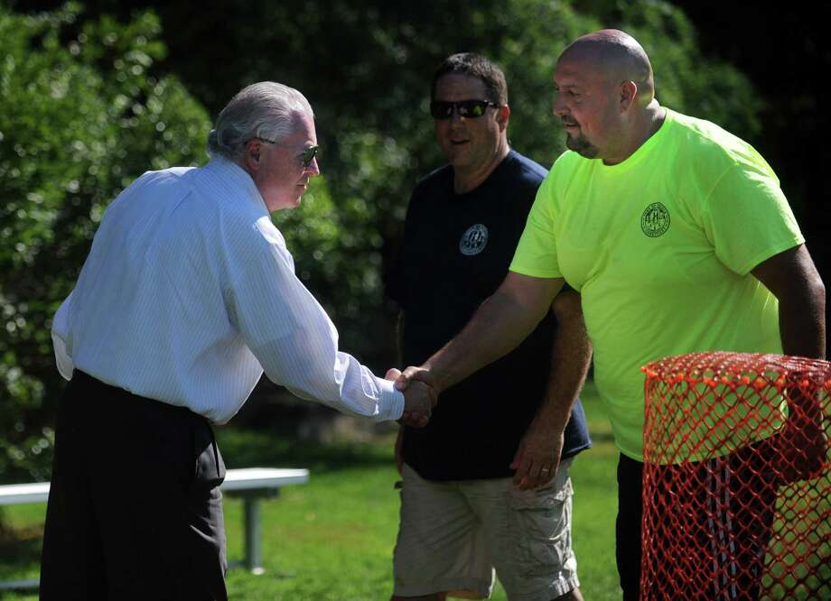 Town Hall, Police Dept., Fire Dept., and Public Works employees compete in a Wiffle Ball tournament Saturday, Sept. 27, 2014 at Roger Ludlowe Middle School to celebrate Fairfield's 375th anniversary. Photo: Autumn Driscoll / Connecticut Post