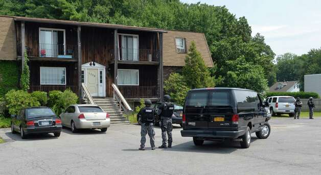 Albany County Sheriff's SWAT team stands outside 1779 Central Avenue Aug. 31, 2014 in Colonie, N.Y. during a drug bust at that location.       (Skip Dickstein/Times Union) Photo: SKIP DICKSTEIN