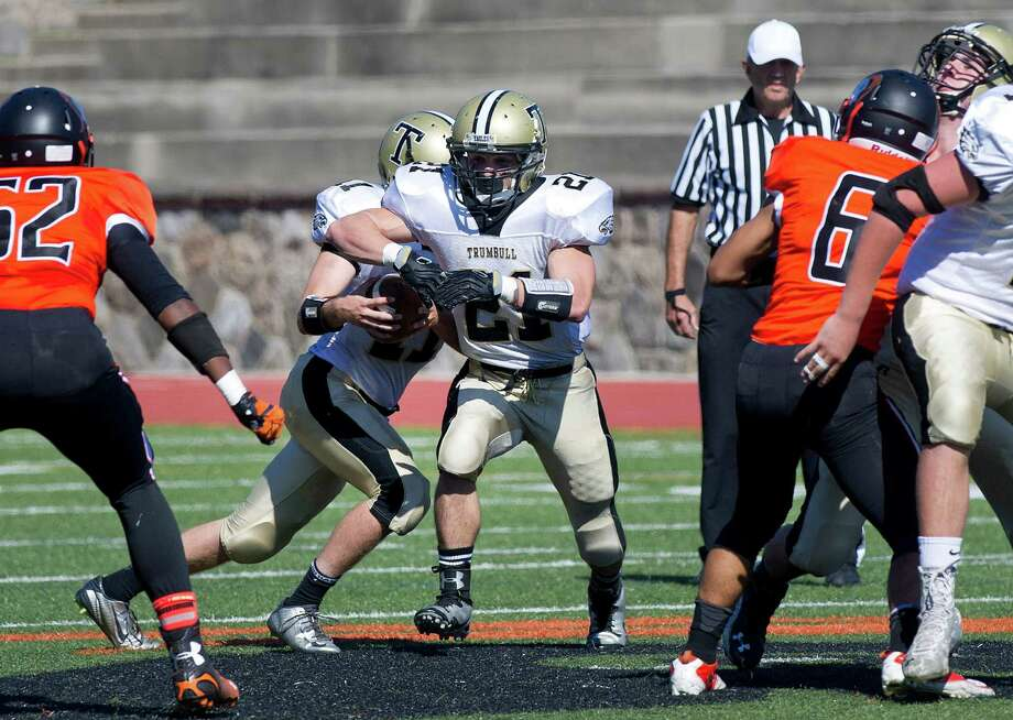 Trumbull's Stephen Nagy fakes the pass to Adam Angelucci during Saturday's game at Stamford High School on September 27, 2014. Photo: Lindsay Perry / Stamford Advocate