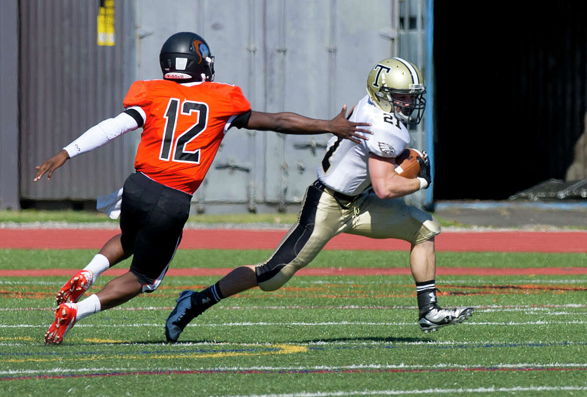 Trumbull's Adam Angelucci carries the ball during Saturday's game at Stamford High School on September 27, 2014.